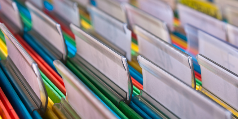 An open file drawer with colorful files