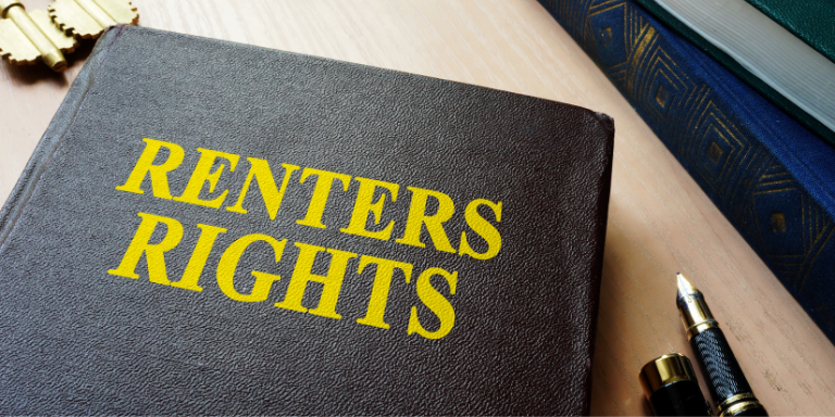 A blue leather book with gold text that says: Renters Rights
