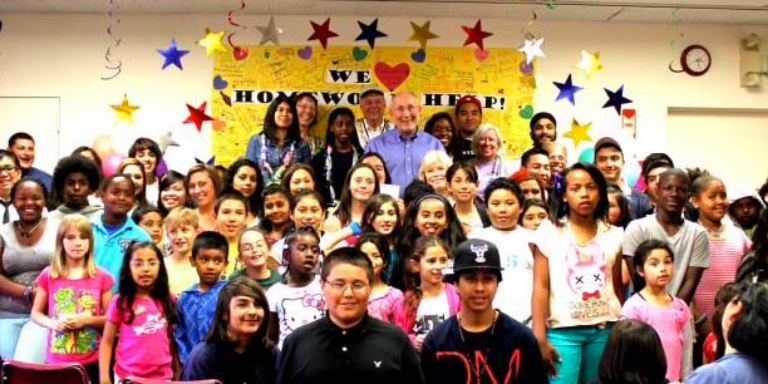 A group of students with after school homework support volunteers