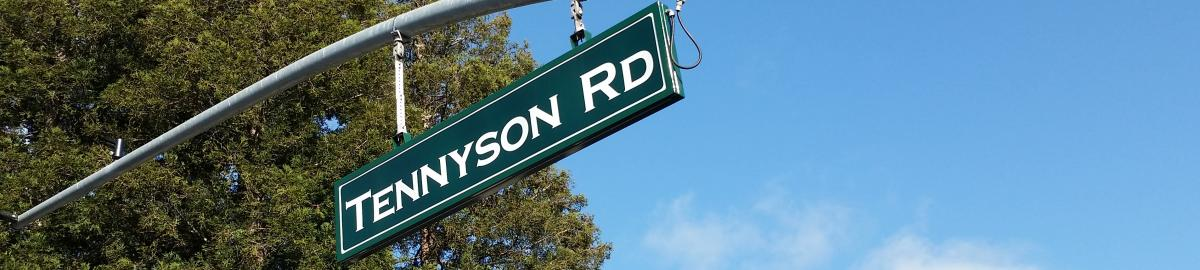 A green road sign that says Tennyson Rd.