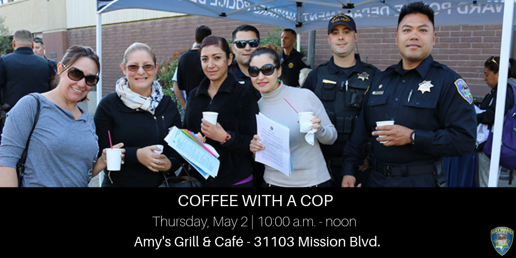 Four women having coffee with three police officers