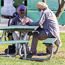 Two men talking at a park