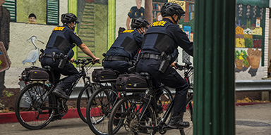 A group of police officers riding their bicycles in Downtown Hayward