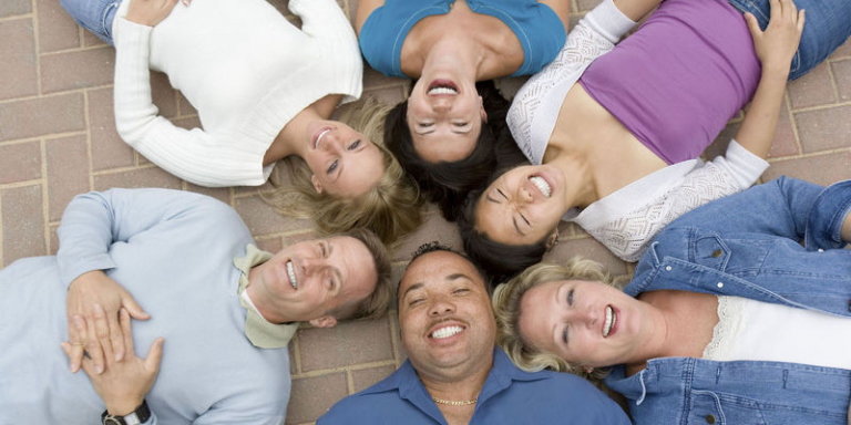 Adults lying in a circle
