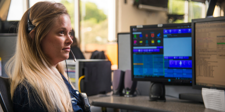 a woman working in the dispatch center