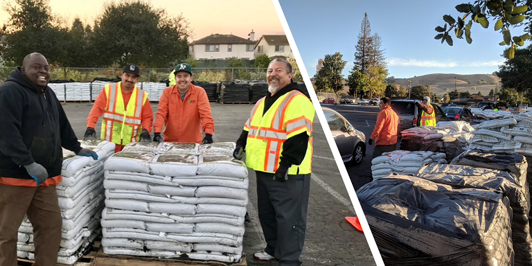 Hayward Maintenance Service staff members handing out compost