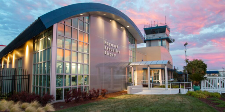 Hayward Executive Airport with a blue and pink sunset
