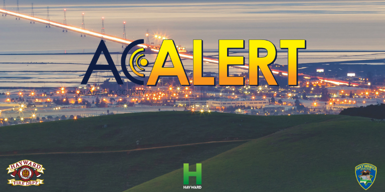 Overlooking Hayward from the Stonebrae golf course in the evening. The words AC Alert are over the image.
