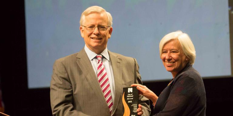 Mayor Halliday receiving the Beacon Award
