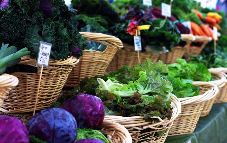 Fresh fruits and veggies displayed at a farmer's market