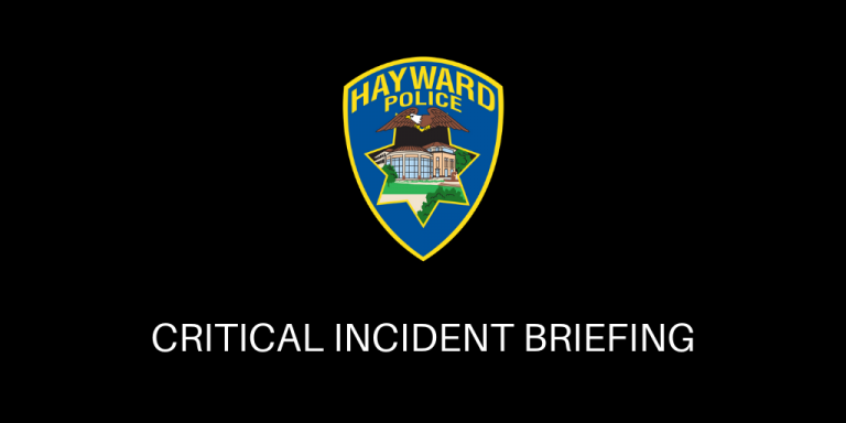 "Black background with Hayward Police Shield in the center. White text below says "" Critical Incident Briefing"""