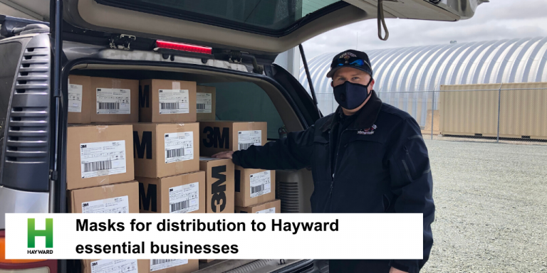 A man standing in front of boxes of masks