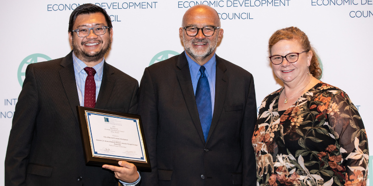 Economic Development staff members Paul Nguyen and Catherine Ralston smiling at the IEDC Awards